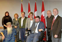Jim Derksen, Shelly Rattai, Rose Flaig, John Young, Minister Diane Finley, Minister Steven Fletcher, Ross Young, Ken Burford